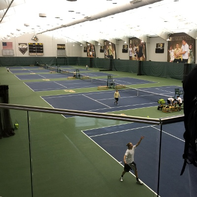 Tennis players at an indoor court