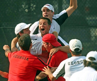 Male tennis players celebrating