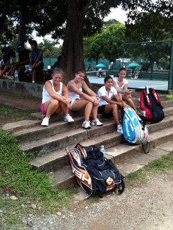 Tennis players sitting on steps