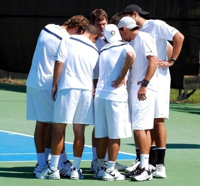 Male tennis players in a huddle