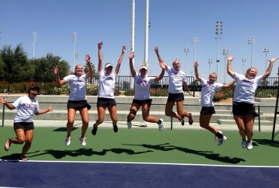 Female tennis players jumping in the air